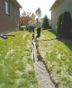 Roof Water and Down Spouts Channeled into French Drain
