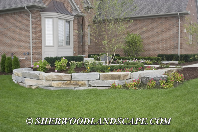 Natural stone landscaping macomb county landascaping for Natural rock landscaping