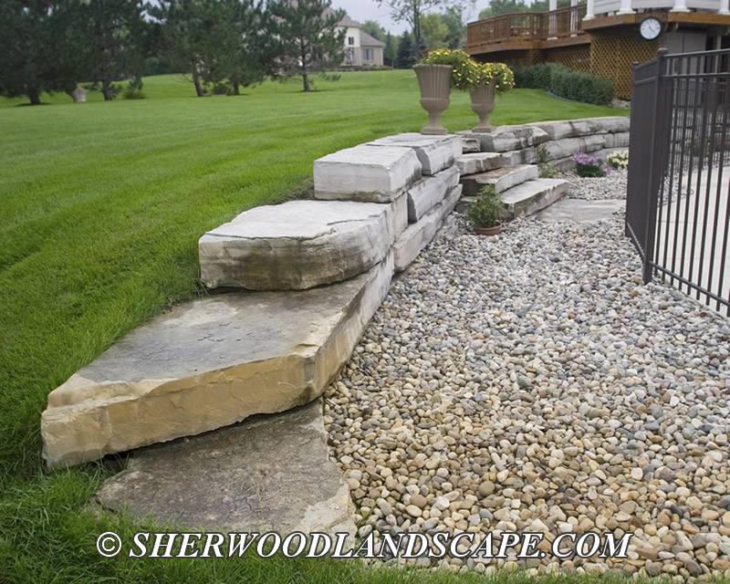 Natural stone macomb county landascaping for Natural rock landscaping
