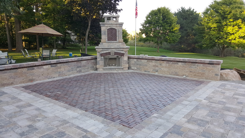 brick-paver-outdoor-living-space-fireplace-patio-retaining-wall