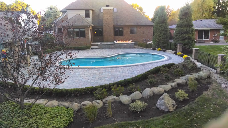 brick-paver-pool-deck-fire-table-landscape-stone