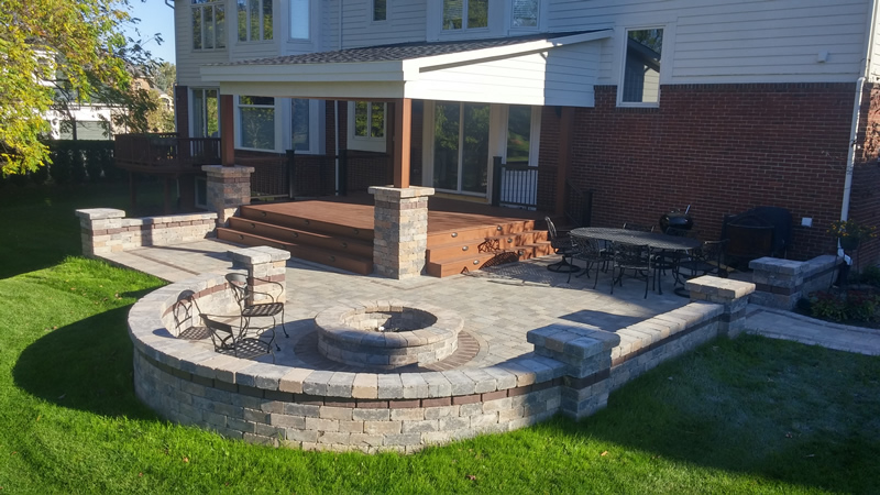 outdoor-living-space-firepit-brick-paver-patio-wood-deck-retaining-wall