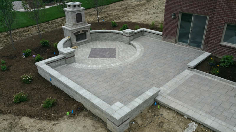 outdoor-living-space-stone-retaining-wall-paver-fireplace-patio-3