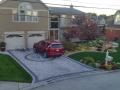 brick-paver-driveway-stone-retaining-wall-plantings
