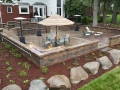 outdoor-living-space-brick-paver-fireplace-patio-retaining-wall-fire-table
