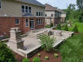 outdoor-living-space-brick-paver-patio-steps-retaining-wall-kitchen-2