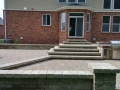 outdoor-living-space-brick-paver-patio-steps-retaining-wall-kitchen
