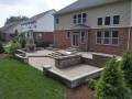 outdoor-living-space-fireplace-kitchen-patio-stairs-retaining-wall