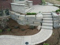 outdoor-living-space-stone-retaining-wall-paver-fireplace-patio-2