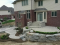outdoor-living-space-stone-retaining-wall-paver-fireplace-patio